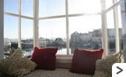 Ellerys Cottage- Sitting room with views of the harbour and beyond.